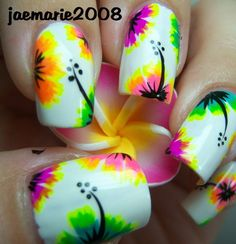 Easy flower nails. Put a small blob of black polish on an edge of the nail and spread it towards the middle with a toothpick. Repeat with more colors in from the black.
