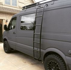 Sportsmobile Sprinter 4x4 van with Aluminess ladder and roof rack.
