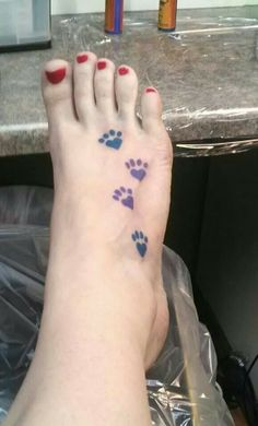 Paw print tattoo for my dogs