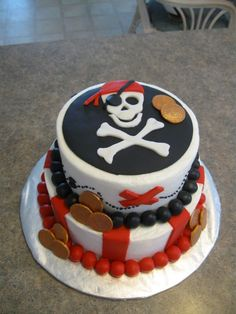 Fantastic cake for a pirate themed birthday party! Love the gold coin details.