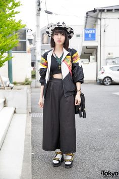 Lana is a Japanese engineer. Her jacket is from Kinsella, worn over a Murua crop top and Nadia wide leg pants. Her bucket bag is from Goocy and her sandals are Lowrys Farm (worn with socks). Her accessories include a beads and cross necklace, a cow print hat, golden watch, heart ring, as well as other rings from Nadia. Lana's favorite band is B1A4.