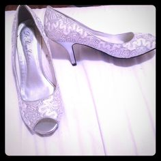 Silver Heels - Size 8 1/2 Gorgeous glass like slippers! These heels are silver with gray/white embroidered lace. Only worn once. Vicki Shoes Heels
