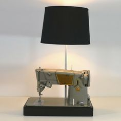 Singer Sewing Machine Lamp now featured on Fab. I have an old Singer machine from the in my attic that looks similar to this one.looks like it could have a new life as a lamp. Sewing Machine Tattoo, Mini Bar, Old Sewing Machines, Sewing Table, Modern Kitchen Design, Vintage Lighting, Lampshades, Vintage Sewing, Tech Accessories
