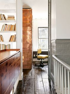 Modern home office with copper-covered walls