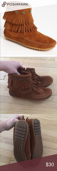 Minnetonka moccasin fringe booties Only worn 2 times but has small scuff on heel. See last photo on bottom right hand side. Minnetonka Shoes Ankle Boots & Booties