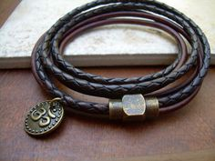 This double strand, triple wrap leather bracelet features an Om charm and a solid antiqued brass magnetic clasp. The secure clasp (17 mm) is great for easy on and off and serves as an industrial looking focal point. This bracelet is sure to be one of your favorites. This