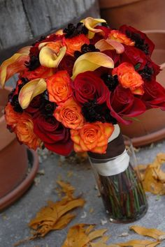 Fall bouquet - Simple, lovely color scheme, playing with shape using lilies and roses....this is what I need