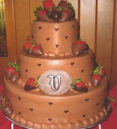 This decadent chocolate cake contained raspberry filling and was decorated with chocolate-dipped strawberries. Use it for a wedding cake, as this couple did, or for an anniversary.