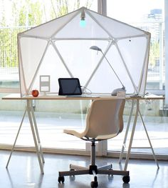 Atmos is a must-have desk for those who prefer their own personal space in a crowded office or dorm. The design takes inspiration from Buckminster Fuller's geodesic structures and Do Ho Suh's fabric cladding sculptures. Designer: Jeremy Lee | via YankoDesign.com