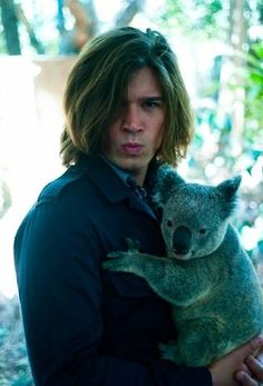 Zac Hanson makes the same face college girls make and still has two kids and is holding a koala. I think I died