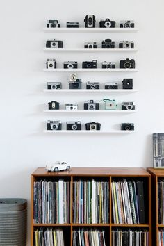 escuyer:  Vintage cameras  Killer vintage camera wall display!!