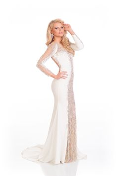 Grace Levy, Miss Great Britain, poses in a gorgeous white gown with beading. See also her 'patriotic' national costume.