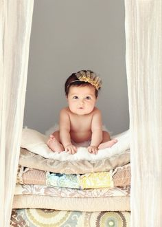 Princess and the Pea Picture - Stack blankets and towels to create a piling-high mattress effect. Top it all off with your precious bundle and then click for a fairytale photo. Thankfully your little princess doesn't actually need 20 mattresses to sleep peacefully.