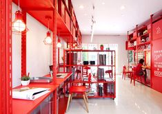 Illustrating the power of primary colors in design is this cool office of Bangkok-based design firm, Apostrophy's. Using color psychology, each room is assigned one color while a saturation of each pigment connects one floor to the other. #color #travel #world #colorful #indoor #office #Bangkok #ColorPsychology #red #yellow #blue
