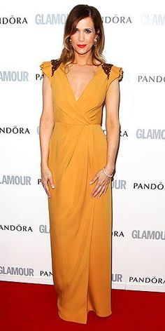 From punch lines to hemlines, the Bridesmaids star keeps it fresh, rocking a saffron J. Mendel gown at the Glamour awards in London.