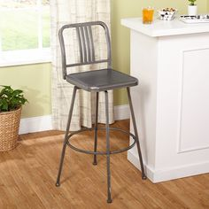 Enjoy the versatility and industrial style of the Skyler adjustable height and swivel barstool. With its sturdy metal construction, grey distressed finish and adjustabiity it has everything you need.