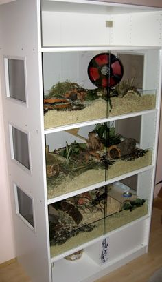 Made from Ikea Pax units, sliding doors with glass panel behind to stop the wood shavings and hamster falling out when doors open.