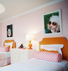 Adore the fun pics above the beds- girls' room, for two! Pink & green girls' room.