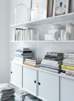 The String Shelving System in white and plexi http://www.nest.co.uk/browse/brand/string/string-shelf-system-white-plexi
