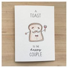 A TOAST TO THE HAPPY COUPLE Wedding Greeting Card   Cards: - kenzieCARDS are a handmade brand of greeting cards, created using a combination of watercolour & ink. The front of each card features a sweet and simple image paired with clever puns and playful wording. Their quirky yet charming disposition make kenzieCARDS great gifts for all ages and celebrations!  Packaging: - Each card is individually wrapped in its own plastic sleeve to protect from water damage  Size: Card: 5 x 6 7/8 (12.7 x…