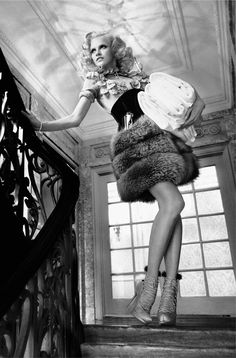 Ginta Lapina plays housemaid in Greg Kadel's tongue in cheek story for Vogue Germany