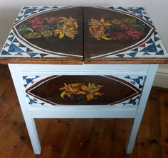 Vintage sewing table with hand painted lilies on by Furniturefruit