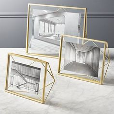 Prisma Gold Frames: Prismatic structure frames your favorite photos with new dimension. Handcrafted of brass-powdercoated steel, metallic rods angle a geometric form that freestands vertically or horizontally to float an image in clear glass. Geometric Decor, Geometric Form, Unique Picture Frames, A Frame Cabin, Home Decor Mirrors, Home And Deco, Desk Accessories, Resin Crafts, Glass Shelves