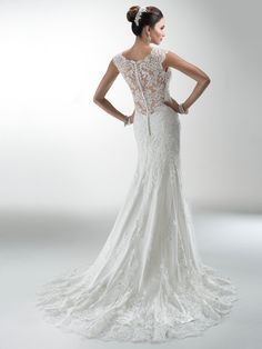 Maggie Sottero - MELANIE, Delicate corded lace on tulle skims the shoulders and neckline of this lightweight wedding gown with attached Monroe slip dress while buttons trail a zipper closure accenting a deep, illusion back.
