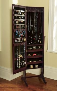 Jewelry Armoire Our Jewelry Armoire is a full-length mirror with a secret it opens to hold and organize LOTS of jewelry! No more tangled necklaces and chains, no more missing earrings they all fit.