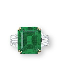 AN EMERALD AND DIAMOND RING, BY HARRY WINSTON  Set with a rectangular-shaped emerald weighing approximately 11.28 carats, flanked by tapered baguette-cut diamonds, mounted in platinum and 18k yellow gold,