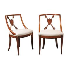 Pair of Austrian Biedermeier 1840s Armchairs with Trophy of Arms Pierced Backs | From a unique collection of antique and modern armchairs at https://www.1stdibs.com/furniture/seating/armchairs/