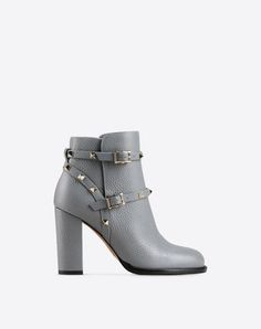 Are you looking for Valentino Garavani Rockstud Ankle Boot? Find out all the details at Valentino Online Boutique and shop designer icons to wear.
