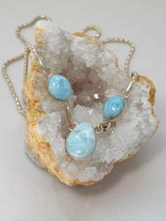 Delicate Caribbean Larimar necklace, featuring 3 polished cabachon oval and teardrop-shaped Larimar gemstones including a teardrop center stone, bezel-set in 925-hallmarked sterling silver. Similar pe