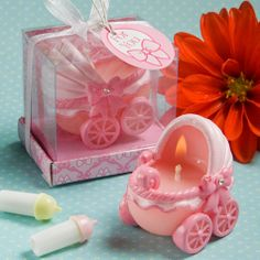 Give your guests - and your new baby girl - a welcoming memento, with these adorable baby pink carriage candles. Every new parent will tell you that taking their baby for a walk in the carriage provides a joyful opportunity to proudly show off their new addition. So, for a day that's designed to celebrate your new baby girl, this cute-as-can-be keepsake will help you show her off in style!