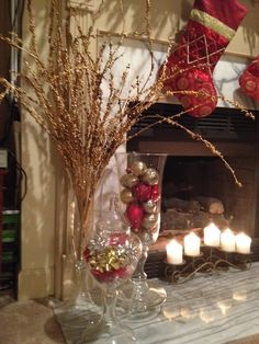 Christmas decor-golden branches from Kirklands, ornaments, and bows in vessels from Pottery Barn