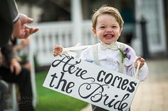 "A great idea that Meg came up with - thanks to Pinterest! Luke - her ring bearer - carried a sign that said ""Here comes the bride"" on one side and when he left, he turned it around and the other side said ""And they lived happily ever after...""  LOVE! <3"