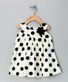 For your baby girl! {Cream Polka Dot Yoke Dress - Toddler & Girls by Willoughby} I am in polka-dot heaven today!Crafted out of breezy cotton, this yoke dress has precious pleats and a floral accent that will have sweethearts swooning. The half zipper Toddler Girl Dresses, Little Girl Dresses, Toddler Outfits, Girls Dresses, Toddler Girls, Infant Toddler, Baby Dresses, Little Girl Fashion, Fashion Kids