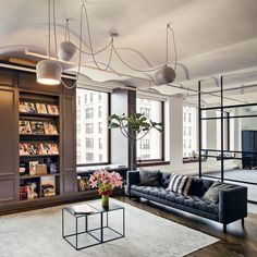 Library and break out space designed by Office AO. FLOS AIM pendant by Ronan and Erwan Bouroullec. Furniture and rug by ABC Home. Photo by James Chororos