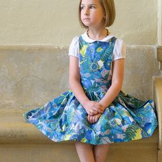 An adorable pinafore with completely adjustable straps that tie in the back for a perfect fit all season long.  A...
