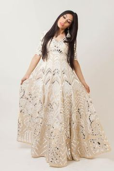 Cream silk linen meets silver matte leather in this indo western one piece gown. Features a statement open back. Indian Attire, Indian Outfits, Indian Wear, Clothing Boutique Interior, One Piece Gown, Mode Bollywood, Eastern Dresses, Indian Gowns Dresses, Anarkali Gown