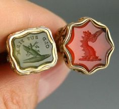TWO VICTORIAN FOB SEALS WITH CARVED CARNELIAN  AGATE INTAGLIO STONES - c1860's