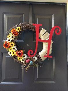 "18 inch grapevine wreath with birds nest, birds, burlap, flowers and ""H"" initial  custom made by awreathforyouca"