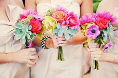 love the pops of color in these fuchsia bridesmaid bouquets