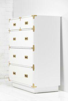 "Brass fittings add Continental panache. ""Jet Setter Dresser"" #decorating #DIY #tips"