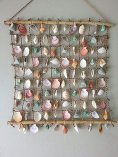 Wall hanging with shells from the beach. Wall hanging with shells from the beach. Wall hanging with shells from the beach. Seashell Art, Seashell Crafts, Beach Crafts, Diy And Crafts, Arts And Crafts, Seashell Display, Crafts With Seashells, Seashell Decorations, Seashell Wind Chimes