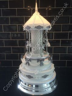 Carousel Wedding Caje by Paul of Happy Occasions Cakes. - http://cakesdecor.com/cakes/209237-carousel-wedding-caje