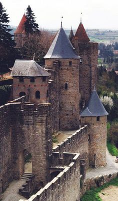 Outer defenses of Chateau Comtal, a 12th-century hilltop castle, and the city walls of Carcassonne, France