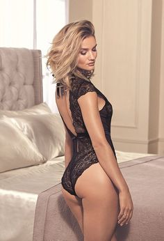 Cheeky: The 28-year-old model displayed her pert posterior and perfectly toned figure in the lingerie