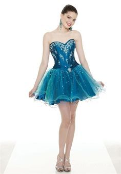 This dress looks like a fairy dress, and the model looks like Mrs. Boyle