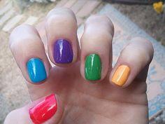 Mismatched rainbow nails.